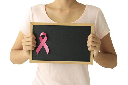 Foto per healthcare and medicine concept. Woman hand holding pink breast cancer awareness ribbon. - Immagine Royalty Free