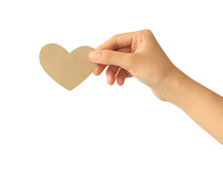 Photo for Woman hand holding paper heart isolated on white background - Royalty Free Image