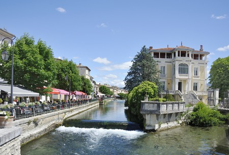 View at Isle-sur-la-Sorgue with the river Sorgue and some restaurants Sorgue river running trough town of L