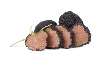 Photo pour Black truffles isolated on a white background. Fresh sliced truffle. Delicacy exclusive truffle mushroom. Piquant and fragrant French delicacy. Clipping path - image libre de droit