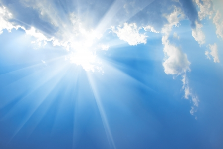 Beautiful blue sky with sunbeams and clouds  Sun rays