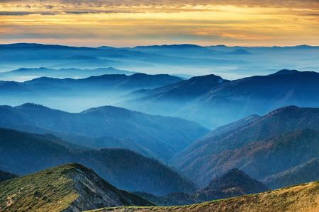 Photo pour Blue mountains and hills over beautiful sunset - image libre de droit
