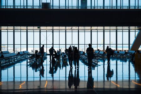 Photo pour Group of silhouette people in airport go to registration with luggage - image libre de droit