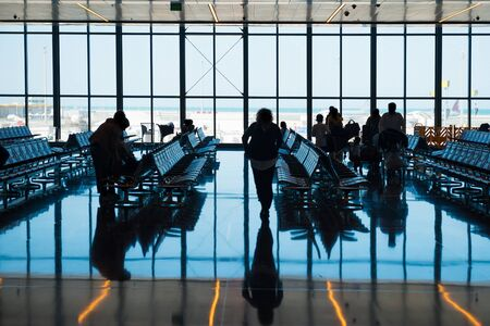 Photo for Group of silhouette people in airport go to registration with luggage - Royalty Free Image