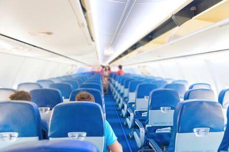 Photo pour Empty plane interior with few people and stewardess during coronavirus pandemia - image libre de droit