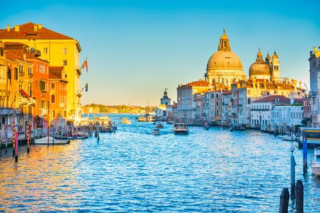 Foto de Sunset view of Grand Canal with boats and Basilica Santa Maria della Salute. Venice, Italy - Imagen libre de derechos