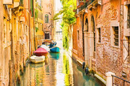 Foto de Morning in Venice street with canal, boats and gondolas - Imagen libre de derechos