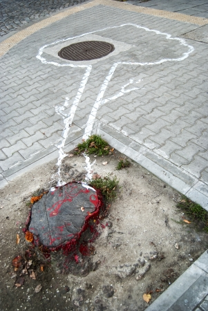 Symbolically painted silhouette of cut down tree on the sidewalk as concept