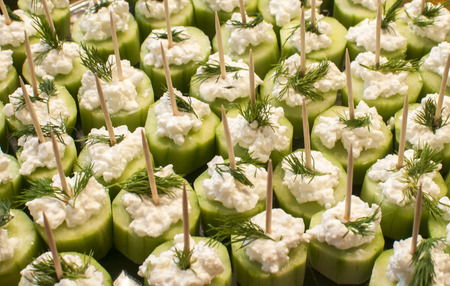 Vegetable cocktail bites with cucumber chunks white cheese pate and dill closeup as appetizer