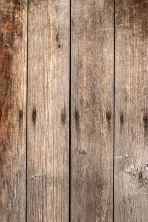 Photo pour Old grunge weathered wooden boards closeup as wooden background - image libre de droit