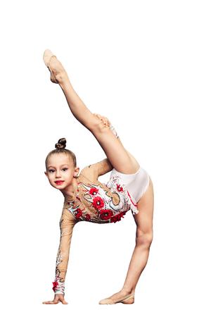 Foto de Little girl is engaged in rhythmic gymnastics isolated on white - Imagen libre de derechos