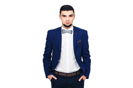 young elegant man in a blue suit, confident successful businessman or showman. isolated on white