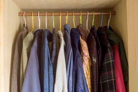 Photo pour Several clothes lined up worn in the wardrobe - image libre de droit