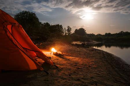 camping at night with campfire