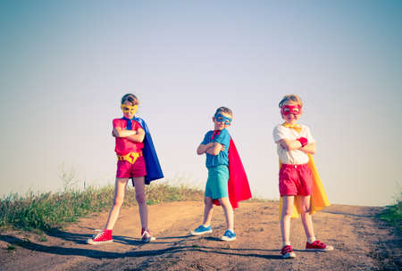 Photo pour kids acting like a superhero retro vintage  - image libre de droit