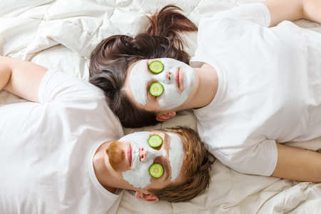 Couple getting homemade facial maskの写真素材