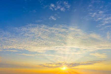 Photo pour a cloudy sunset landscape with sun - image libre de droit