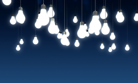Hanging glowing light bulbs on blue background