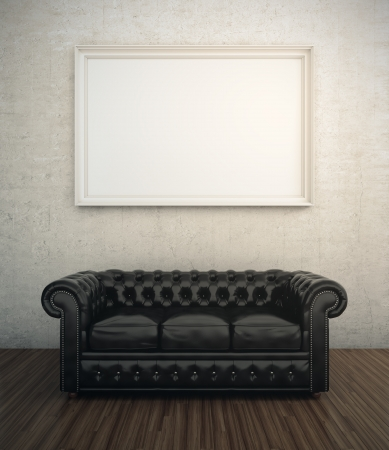Black leather sofa next to white wall with blank frame