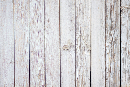 Photo pour Pleasant abstract empty background of wooden boards, painted with white paint, which eventually began to crumble - image libre de droit