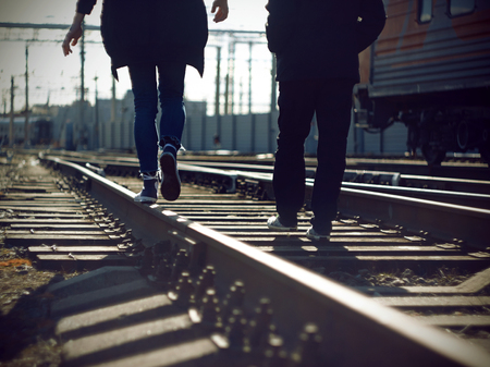 Two carefree and risky teenagers are engaged in dangerous business - go on railway tracks.