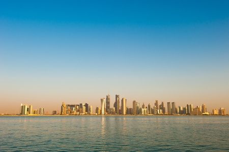 Skyline of the arabian city of Doha in Qatar, captured in the very early morning with the rich warm colours from the sun reflecting off the glass skyscrapers.  This skyline changed drastically over the past 5 years and this image was captured on 29 Octobe