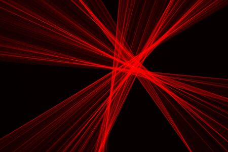 Photo pour Abstract red lines drawn by light on a black background. Laser lines - image libre de droit