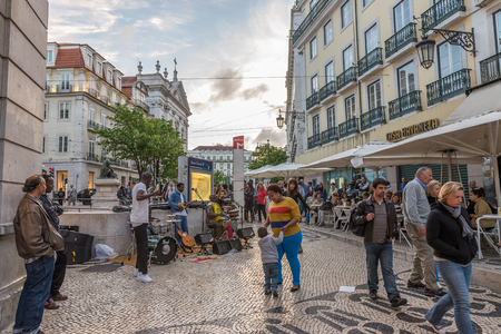 Lisbon, Portugal - April 22, 2014: Group of  unidentified street musicians play songs and music in the city square for the tourists and citizensa appreciation in Lisbon, Portugal.