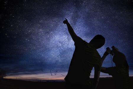 Photo for Silhouettes of people observing stars in night sky. Astronomy concept. - Royalty Free Image