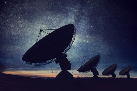 Photo for Silhouettes of satellite dishes or radio antennas against night sky. Space observatory. - Royalty Free Image