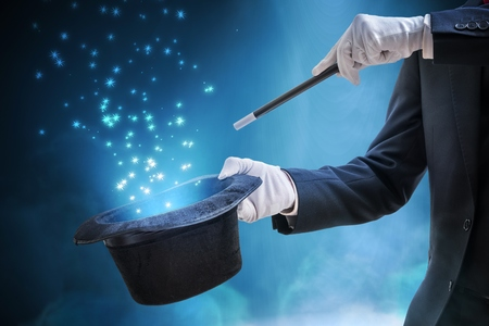 Photo for Magician or illusionist is showing magic trick. Blue stage light in background. - Royalty Free Image