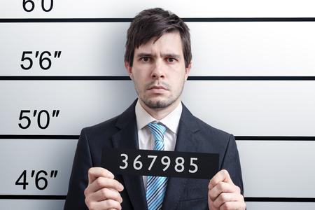 Photo pour Mugshot of young guilty man at police station. - image libre de droit