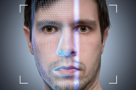 Photo pour Biometric scanner is scanning face of young man. Artificial intelligence concept. - image libre de droit