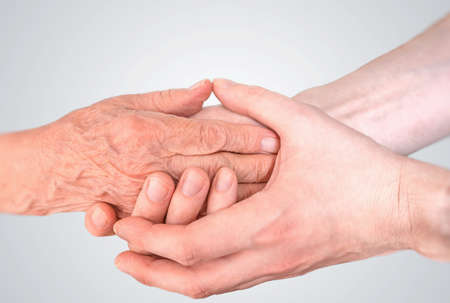 Photo for Man holds hands of eldery woman. Senior help and assistance concept. - Royalty Free Image