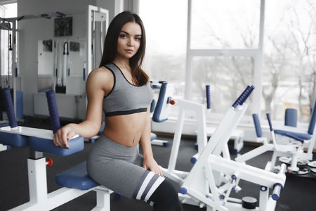 Photo for Beautiful girl in the gym, sportswear, athletic build - Royalty Free Image