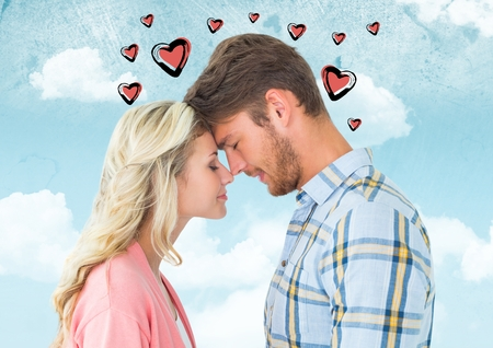 Composite image of romantic couple with heart embracing face to face