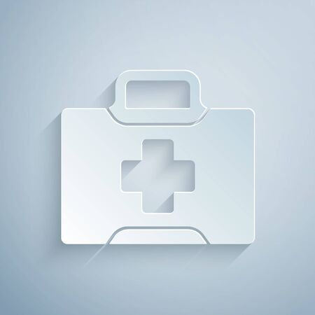 Illustration pour Paper cut First aid kit icon isolated on grey background. Medical box with cross. Medical equipment for emergency. Healthcare concept. Paper art style. Vector Illustration - image libre de droit