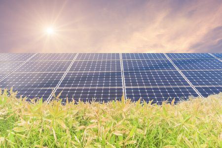 Photo for Solar  power panels for innovation green energy for life with mountains with sunrise and  sky background. - Royalty Free Image