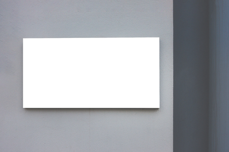 Photo pour Mock up. Blank billboard outdoors, outdoor advertising, public information board on gray wall. - image libre de droit
