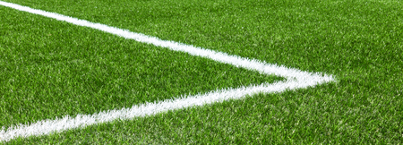 Photo for Green synthetic artificial grass soccer sports field with white corner stripe line - Royalty Free Image