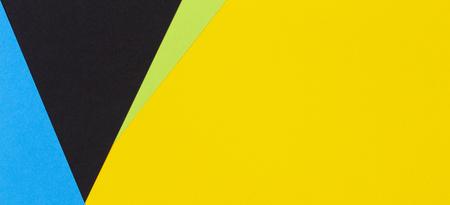 Photo pour Geometric flat lay yellow green blue and black color paper background - image libre de droit