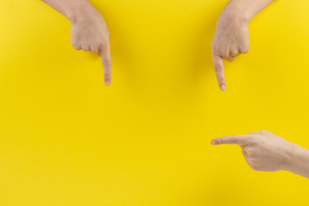 Foto de Child hands fingers pointing on yellow background - Imagen libre de derechos