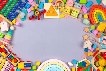 Photo pour Baby kids toys frame. Colorful educational wooden plastic and fluffy toys for children on gray background. Top view, flat lay - image libre de droit