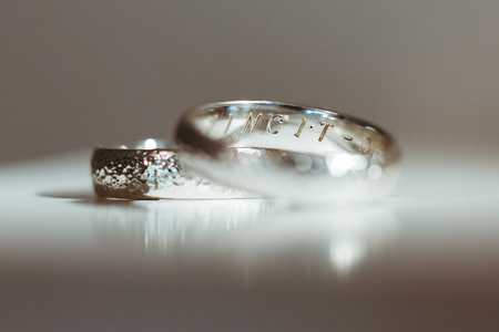 Foto de Pre-wedding preparation. Two silver wedding rings for weds. Closeup, no people - Imagen libre de derechos
