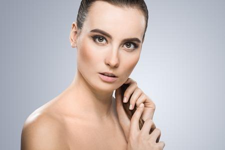 Photo pour Model holding pigtail - image libre de droit