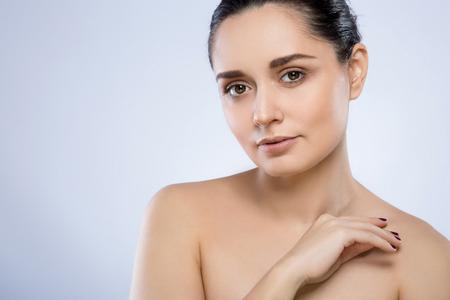 Photo pour Beautiful girl with nude make up at studio - image libre de droit