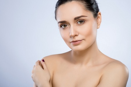 Photo for Beautiful girl with nude make up at studio - Royalty Free Image