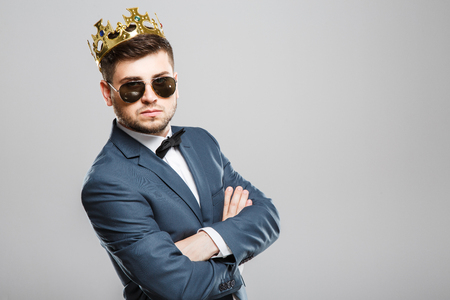 Serious man in crown