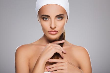 Foto de Beautiful girl with nude make up at studio - Imagen libre de derechos