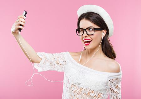 Photo pour Happy girl posing at pink background - image libre de droit